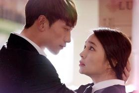 CHEMISTRY: (Above) Rain and actress Lee Min Jung in South Korean drama Come Back Alive.
