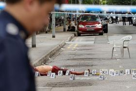 EXPOSED: (Above) Mr Niu-ge's bloodied body at the roadside along Lorong 23 Geylang.