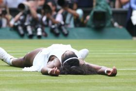 JUST LIKE HOME: Serena Williams lying on Centre Court after sealing her seventh Wimbledon crown.