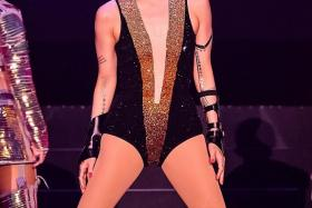 MAKING AN ENTRANCE: Sammi Cheng kick-started her two-hour gig dressed in a sexy, skintight leotard.