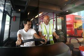 GETTING READY: Bus operator Go-Ahead Singapore staff train in preparation for the bus operator's launch in September.