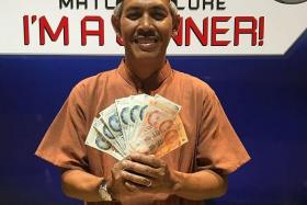 WINNERS: Jackpot prize winners Rahimi Assar (above), Lee Ah Choy and Kamarulzaman Osman each won $340 in cash yesterday. Mr Kamarulzaman won an extra $50 for being a TNP Superkaki.
