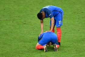 Anthony Martial consoles Andre-Pierre Gignac after France's defeat to Portugal in the Euro 2016 final.