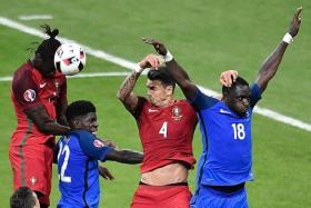 MASTERSTROKE: Fernando Santos' decision to send on substitute Eder (heading ball) causes the France defence problems and wins Portugal the game.