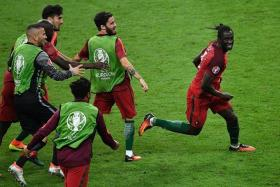HERO: Eder (above) and his Portugal teammates celebrate his goal against France in the Euro 2016 final.