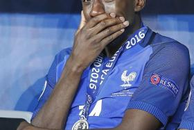 CRESTFALLEN: An inconsolable Blaise Matuidi (above) and a dejected Andre-Pierre Gignac after France failed to add another European title to their name.