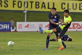 BRIGHT START: Saifullah Akbar (in yellow) marking his professional debut with a goal.