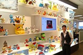 CATCH 'EM ALL: (Above) Pokemon fan Ng Soon Aik at The Pokemon Company International Office.