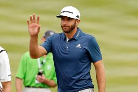 MAN TO WATCH: American Dustin Johnson (above) has a good record at the British Open.