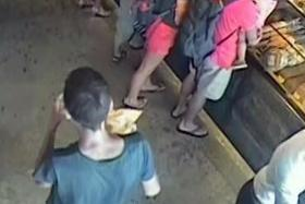 QUICK STOP: (Above) CCTV footage of a man resembling David James Roach in cafe-bakery  Baker & Cook soon after the robbery.