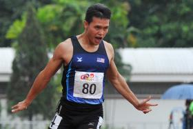 BLUE RIBAND: Malaysia's Jonathan Nyepa (above) wins the men's 100m.