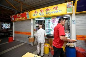 CAUGHT OFF GUARD: Hawkers such as Madam Poh Swee Lan from Na Na Curry  (above) said they had no idea a Michelin Guide inspector had visited their stalls, less so pegged them for awards.