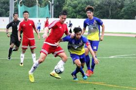 FIGHTING FOR THIRD: After their loss to Thailand (in blue), Ander Eric Aplin's (in red, centre) Singapore will take on Malaysia for the bronze-medal match tomorrow.
