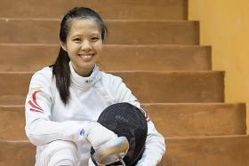 MIND OVER BODY: Playing through pain, Victoria Ann Lim (above) claimed bronze in the women's individual epee on Thursday.