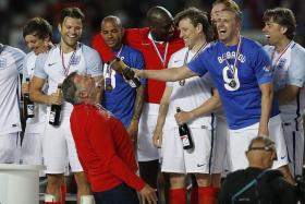 JOB EXPERIENCE: Sam Allardyce (in colour) celebrates after leading an England XI featuring former internationals Kieron Dyer (fourth from left)and Sol Campbell (fifth from left) to a 3-2 win over the Rest of the World XI in a charity football match last month.