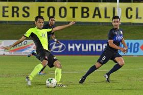 COMEBACK INTERRUPTED: Tampines Rovers' Shahdan Sulaiman (in yellow) scoring against Hougang United last Wednesday in his comeback match, where he came off at half-time due to a recurrence of the hairline fracture in his right leg.