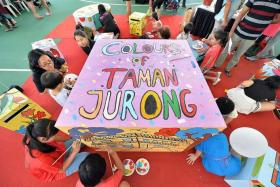 COLOURFUL: Over 10 'POPcubes!', which are furniture pieces to be placed within the Taman Jurong Community Centre, were painted on by Deputy Prime Minister Tharman Shanmugaratnam, residents and students.