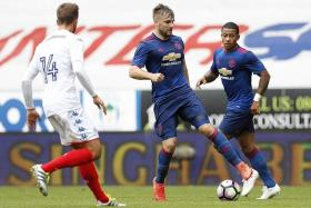 SLOWLY, BUT SHAWLY: Luke Shaw (centre) played 45 minutes against Wigan on Saturday, as he continued his comeback from a 10-month injury lay-off.