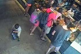 SNAP: A man, said to resemble the Standard Chartered bank robber, was spotted on a cafe-bakery's CCTV recording.