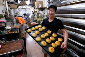 TRADITIONAL TREAT: Mr Lawrence Lim, the second-generation owner of Gin Thye Cake Maker, is one of a few in Singapore that make traditional Teochew pastries and cakes.