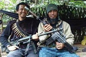 VIOLENT END: (Above) Santoso (head covered), who was shot dead, with his confidant Basri.