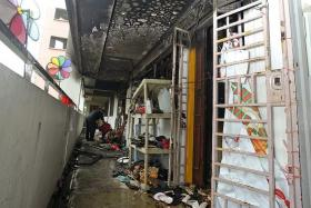 BURNED: The four-room flat was destroyed by a fire, leaving the family living there to salvage whatever they could.