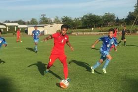 UP AGAINST IT: Yasir Hanapi (No. 4, in red) in action against the Niigata University of Health and Welfare team yesterday.