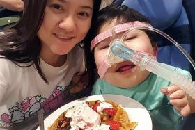 TIGHTLY-KNIT FAMILY: Pei Shan and her mother, Madam Chew Siew Cheng, enjoying a waffle.