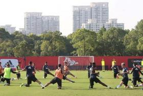 TRAINING: Manchester United players (above) being put through their paces in China, as they prepare for their friendly game against Borussia Dortmund tomorrow. Jose Mourinho, though, is not expected to give Wayne Rooney a run-out.
