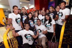 DEVOTED: A group of 30 childhood friends and die-hard fans of Rajinikanth sported matching Kabali T-shirts. With them is Ms Renu Ananthan, 31, (centre, in black) who braved the crowds despite being eight months pregnant.