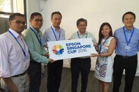 YOUTHS HAVE A CHANCE TO SHINE: (From left) FAS president Zainudin Nordin, Sinad Sports director Bambang Sugeng, managing director of Epson's regional office in Singapore Toshimitsu Tanaka, Sinad Sports chairman Jeremy Chan, Epson Singapore general manager (sales, marketing and customer service division) Tan May Lin and FAS general secretary Winston Lee at the launch of the Epson Singapore Cup yesterday at The Refinery.