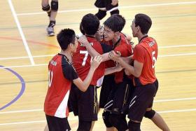 VICTORY: The boys from Shuqun Secondary School celebrating after they forged a 2-1 comeback to beat Hwa Chong Institution yesterday to claim the gold in the South Zone volleyball C Division boys' final.