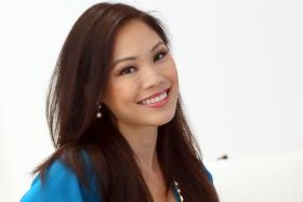 BEAUTY AND BRAINS: Miss Cheryl Tay (above), a vet, was crowned Miss Singapore Universe 2005. She also won the Miss Personality in the same contest.