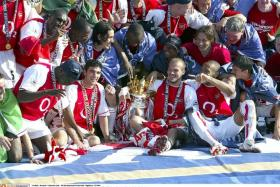 INVINCIBLES: Arsenal's class of 2003/04 (left) were the last Gunners team to win the Premier League.