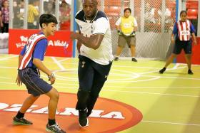 KID FRIENDLY: Above, former England defender Ledley King shows off his skills at KidZania Singapore's indoor stadium.
