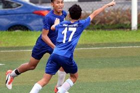 ON TO THE FINAL: Shahrulnizam Mazlan (left) celebrating with teammate Mohammad Nizam after scoring the only goal for Hong Kah Secondary School to send them to the National Schools' B Division final.