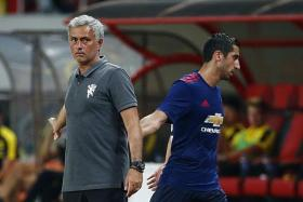 LETDOWN: Jose Mourinho's (left) new signing Henrikh Mkhitaryan (right) was a passenger other than his second-half tap-in.