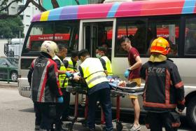 BADLY HURT: Paramedics attending to Ms Yong Soh Mui at the scene of the accident at Lorong 1 Toa Payoh.