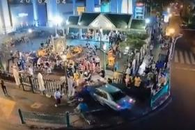 HURT: (Above) A screen grab of the car ploughing into the Erawan Shrine.