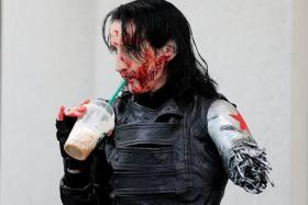 TO SEE AND BE SEEN: (Above) Ms Dawn Richardson, dressed as the Winter Soldier, cooling off with a drink.