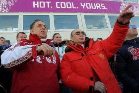 AT SOCHI: Russia topping the medal tally at the 2014 Winter Olympic Games was a source of enormous national pride for president Vladimir Putin (right, with sports minister Vitaly Mutko).