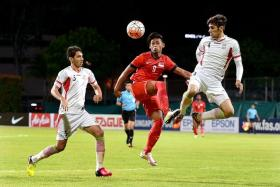 YOUNG GUNS: Singapore striker Amiruldin Asraf (centre) giving a spirited display against the fancied Iranians.
