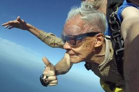 Mr Tan Kok Sing during his fourth skydive. He entered into the Singapore Book of Records as the oldest  skydiver here.