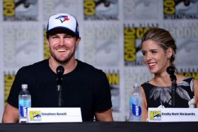 """SAN DIEGO, CA - JULY 23: Actors Stephen Amell (left) and Emily Bett Rickards (right) attend the """"Arrow"""" Special Video Presentation and Q&A Comic-Con International 2016 at San Diego Convention Center on July 23, 2016 in San Diego, California."""