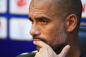 PITCH WOES: Pep Guardiola is more concerned about the state of the pitch at the Bird's Nest Stadium than his rivalry with Jose Mourinho.