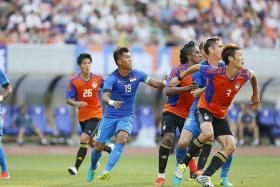 GULF IN STANDARD: The Lions (in blue) were outclassed by an Albirex side featuring mostly second-stringers.