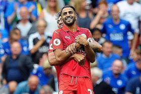 YOU LIFT ME UP: Leonardo Ulloa (behind) celebrates with Leicester City teammate Riyad Mahrez after his wondergoal against Celtic.