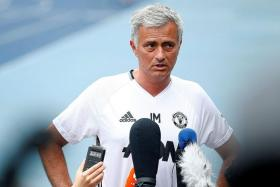IMPROMPTU: Man United manager Jose Mourinho holding a hastily arranged press conference near the running tracks of the Olympic Sports Centre, as the press room was overcrowded and too hot.
