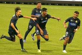MATCH-WINNER: Iqbal Hussain's (No. 14) late strike sends Hougang through to the Plate final.
