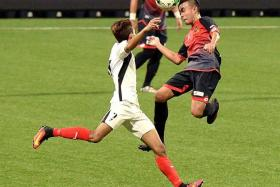 HISTORY IN THE MAKING: Brunei DPMM (in red and black) are one win away from a record four League Cup title triumphs, having won in 2009, 2012 and 2014.